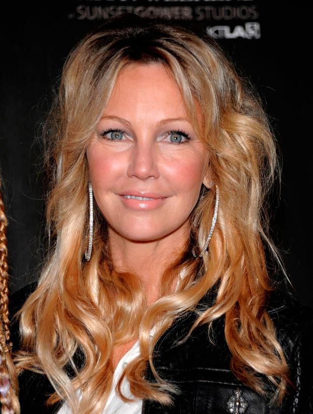 In this Oct. 17, 2010 file photo, actress Heather Locklear arrives at the WTB Spring 2011 Fashion Show at Sunset Gower Studios in Los Angeles. (AP Photo/Dan Steinberg, file)