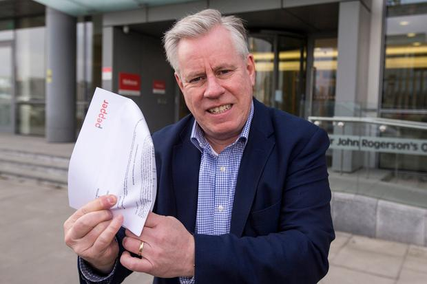 Personal Finance Editor Charlie Weston with his letter from Pepper on Sir John Rogerson's Quay in Dublin. Photo: Mark Condren