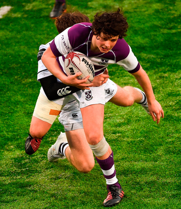 Rory Morrin of Clongowes Wood College is tackled by Daniel Hawkshaw of Belvedere College. Photo: Piaras Ó Mídheach/Sportsfile