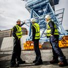 Former crane operators Tony Forde, Liam O'Brien and Paddy Paisley at last year's unveiling by the Dublin Port Company of Crane 292, a restored 1960s crane. Investing in ports and other infrastructure is key to sustaining Ireland's exports post-Brexit. Photo: Conor McCabe