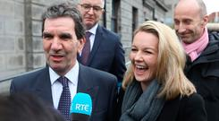 Tom McGuire, head of RTÉ Radio 1, and presenter Claire Byrne pictured speaking to the media outside the Four Courts yesterday after Nicky Kehoe was awarded €3,500 damages following a High Court action. Photo: Collins