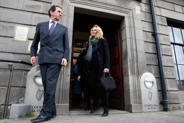 Tom McGuire, head of RTÉ Radio 1, and presenter Claire Byrne pictured outside the Four Courts yesterday after Nicky Kehoe was awarded €3,500 damages following a High Court action. Photo: Collins Courts