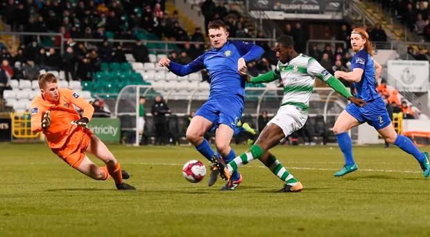 Dean Clarke of St Patrick's Athletic in action against Izzy Akinade of Waterford during the SSE Airtricity League Premier Division match between Waterford and St Patrick's Athletic at the RSC in Waterford
