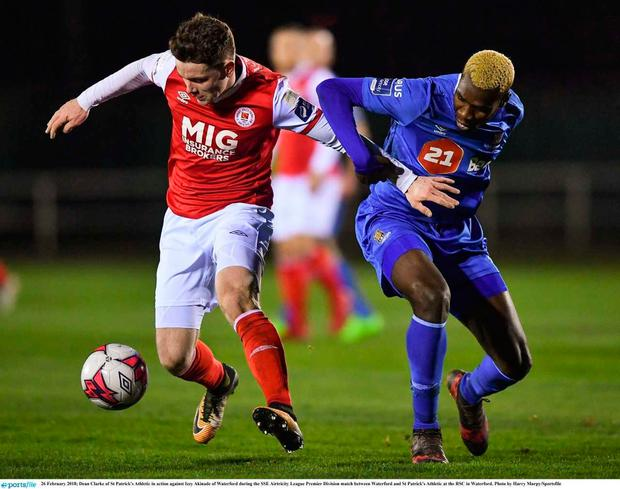 Dean Clarke of St Patrick's Athletic in action against Izzy Akinade of Waterford during the SSE Airtricity League Premier Division match between Waterford and St Patrick's Athletic at the RSC in Waterford (Sportsfile)