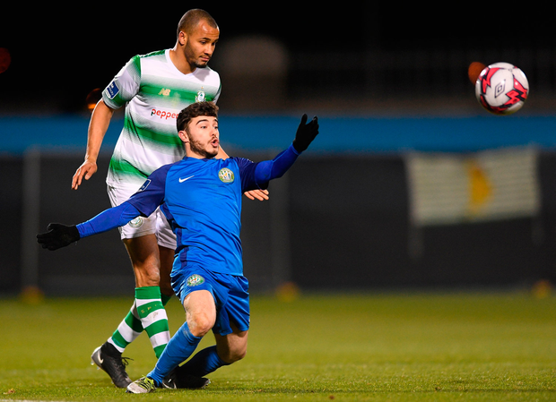 Aaron Greene of Bray Wanderers is tackled by Ethan Boyle of Shamrock Rovers. Photo by Eóin Noonan/Sportsfile