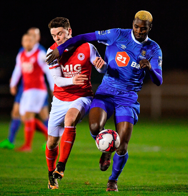 Dean Clarke of St Patrick's Athletic in action against Izzy Akinade of Waterford. Photo by Harry Murpy/Sportsfile