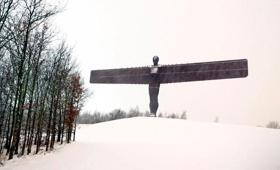 Snow surrounds the Angel of the North in Gateshead, following heavy overnight snow fall which has caused disruption across Britain Owen Humphreys/PA Wire