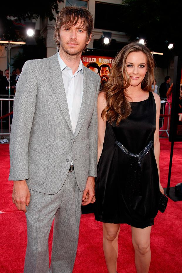 Christopher Jarecki (L) and actress Alicia Silverstone arrive on the red carpet of the Los Angeles Premiere of
