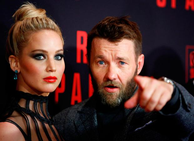 Actors Jennifer Lawrence and Joel Edgerton pose on the carpet for the New York premiere of