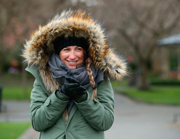 Maila Blaquier, from Argentina attemps to keep warm in a cold St Stephens Green. Picture; Damien Eagers