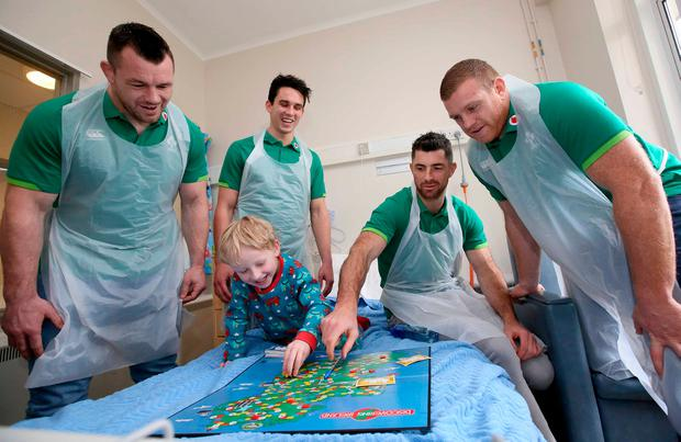 Members of the Irish rugby team visited sick children and their families at Our Lady's Children's Hospital, Crumlin. Pictured is 4-year-old Toby McEntee from Cellbridge, Kildare with Irish Rugby players, from left, Cian Healy, Joey Carbery, Rob Kearney and Sean Cronin. Picture: Mark Stedman