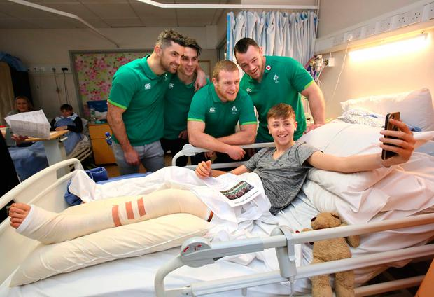 Members of the Irish rugby team visited sick children and their families at Our Lady's Children's Hospital, Crumlin. Pictured is 13-year-old Jamie Collins from Malahide with Irish rugby players Cian Healy, Joey Carbery, Rob Kearney and Sean Cronin. Picture: Mark Stedman
