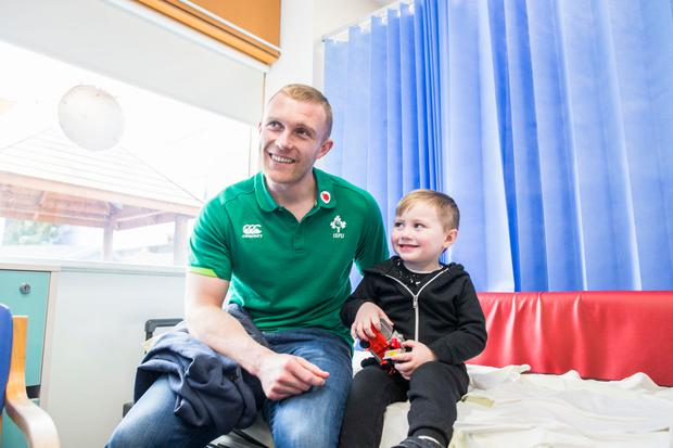 Keith Earls visits the Children's Ark at University Hospital Limerick today. Pictured with Tadgh Joyce McCarthy, age 2, from Ennis, Clare. Picture: Brian Arthur