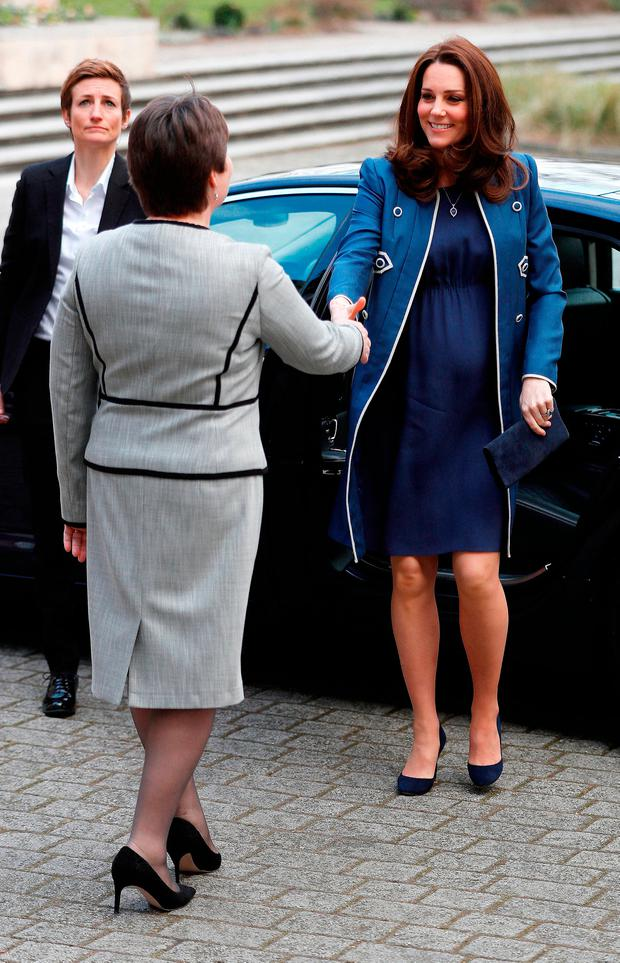 The Duchess of Cambridge is met by President Lesley Regan, as she arrives to visit to the Royal College of Obstetricians and Gynaecologists in London
