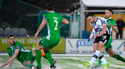 Robbie Benson scores for Dundalk in their rout over Limerick at Oriel Park last night. Photo: Sportsfile
