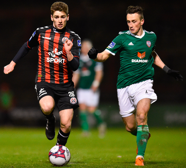 Bohemians' Dylan Watts keeps possession alongside Derry City's Aaron McEneff. Photo: Sportsfile