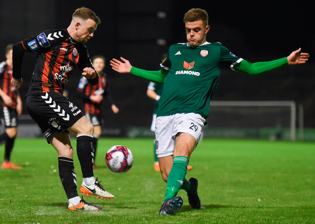 Bohemians' Keith Ward and Derry City's Niall Logue challenge for the ball. Photo: Sportsfile