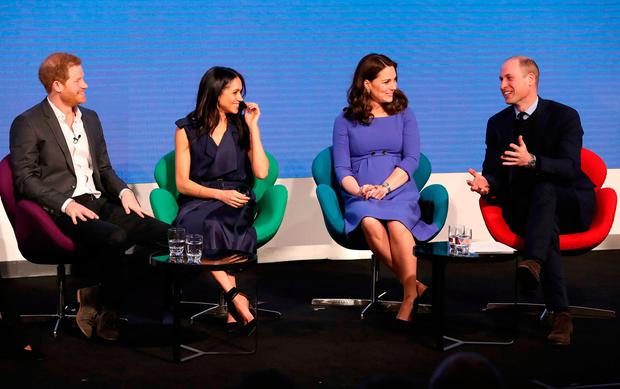 (L-R) Britain's Prince Harry, his fiancee US actress Meghan Markle, Britain's Catherine, Duchess of Cambridge and Britain's Prince William, Duke of Cambridge attend the first annual Royal Foundation Forum on February 28, 2018 in London. / AFP PHOTO / POOL / Chris JacksonCHRIS JACKSON/AFP/Getty Images