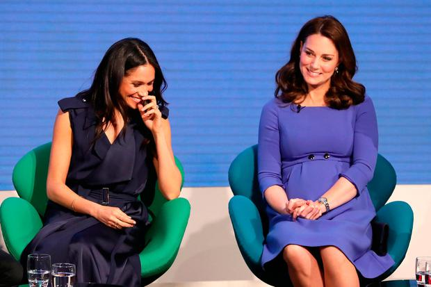 Meghan Markle (left) and the Duchess of Cambridge during the first Royal Foundation Forum in central London
