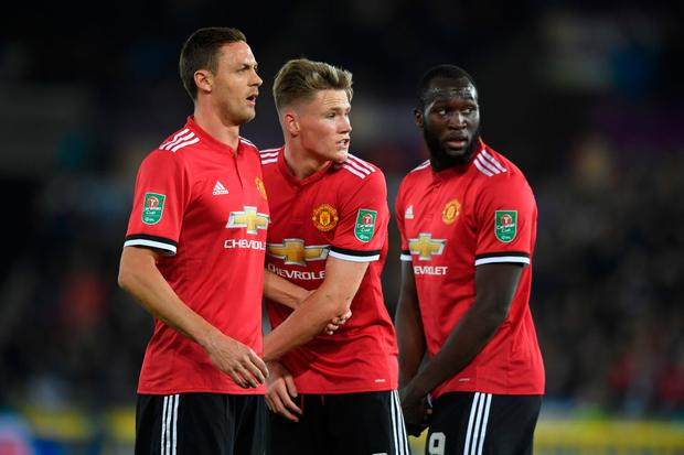 SWANSEA, WALES - OCTOBER 24: Nemanja Matic (l) Scott McTominay and Romelu Lukaku of United in the defensive wall during the Carabao Cup Fourth Round match between Swansea City and Manchester United at Liberty Stadium on October 24, 2017 in Swansea, Wales. (Photo by Stu Forster/Getty Images)