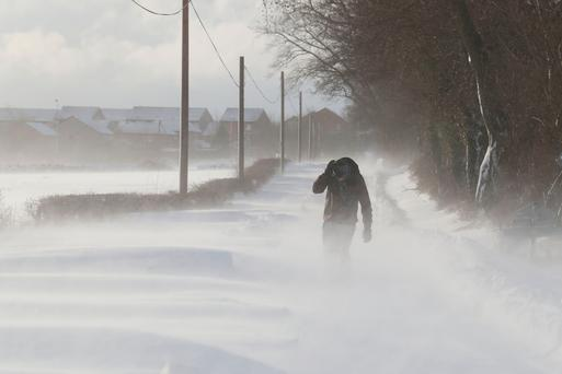 A man walking in snowy conditions in Larbert as storm Emma, rolling in from the Atlantic, looks poised to meet the Beast from the East's chilly Russia air - causing further widespread snowfall and bitter temperatures. Andrew Milligan/PA Wire