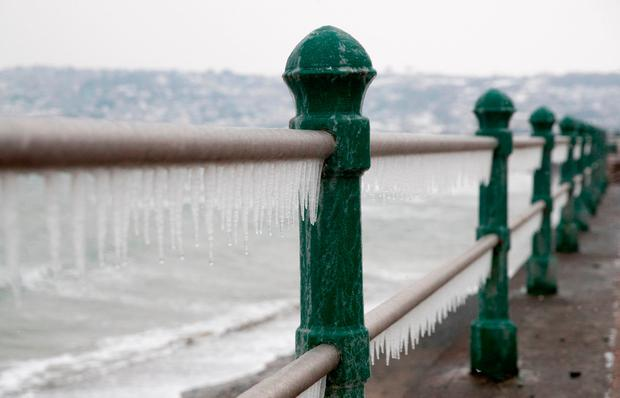 Icicles that have formed on the seafront are pictured, ahead of the arrival of Storm Emma which is set to bring further widespread disruption to many parts of the UK on March 1, 2018 in Cornwall, England. (Photo by Matt Cardy/Getty Images)
