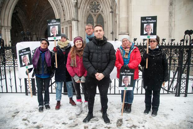 Georgina Challen's son, David Challen (centre) with members of Justice for Women protesting outside the Royal Courts of Justice, London. Photo: Yui Mok/PA Wire
