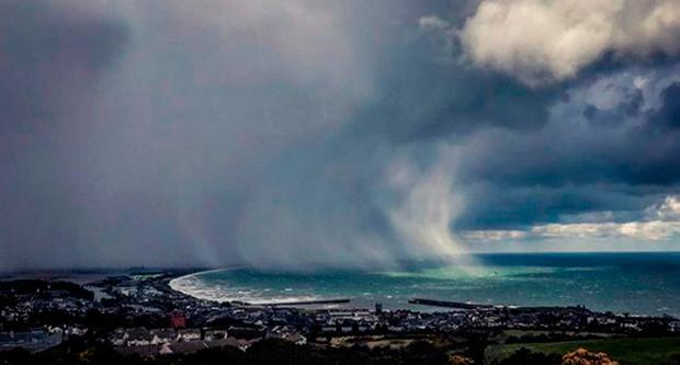 Storm clouds over Dublin Bay, as storm Emma, rolling in from the Atlantic, looks poised to meet the Beast from the East's chilly Russia air - causing further widespread snowfall and bitter temperatures. Stu Teehan Photography/PA Wire