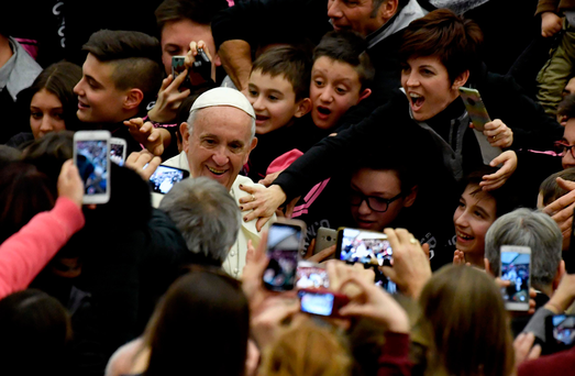 Pope Francis arrives to the Paul VI Audience Hall for his weekly audience at the Vatican on Wednesday. Photo: Getty Images