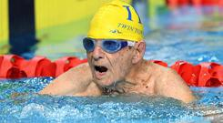 The 99-year-old smashed the previous record by 35 seconds. Getty