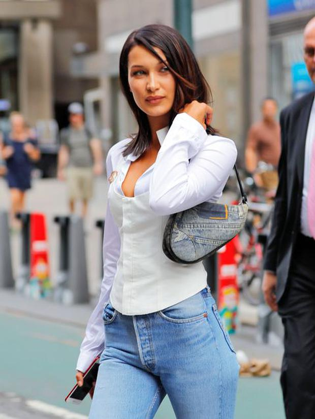 Bella Hadid carrying the Dior saddle bag