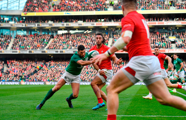 Josh Navidi of Wales beats the cover of Rob Kearney to pass the ball to team-mate Steff Evans who went on to score Wales' third try against Ireland last weekend. Photo by Brendan Moran/Sportsfile