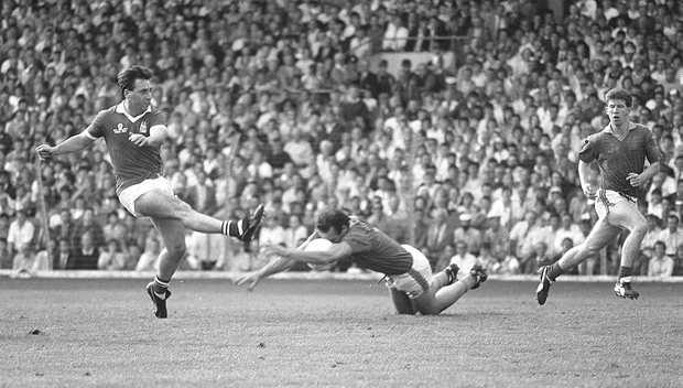WHEN WE WERE KINGS: Cork's Jimmy Kerrigan has his goal effort blocked by Meath's Mick Lyons in the 1987 All-Ireland SFC final. Pic: Ray McManus/Sportsfile.