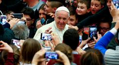 Pope Francis will attend the World Meeting of Families in Dublin to highlight the message and spirit of his Joy of Love exhortation. Photo: Alessandro Bianchi/Reuters
