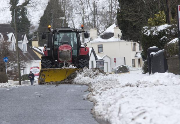 A snow plough clears the snow at Navan, Co. Meath. PIC COLIN ORIORDAN