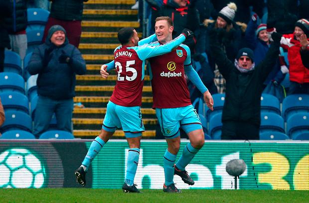 Burnley's Chris Wood (right) celebrates scoring his side's second goal of the game during the Premier League match at Turf Moor, Burnley. Photo credit should read: Dave Thompson/PA Wire.
