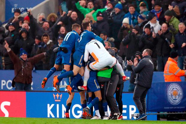 Leicester City's Riyad Mahrez (obscured) celebrates scoring his side's first goal of the game with team-mates during the Premier League match at the King Power Stadium, Leicester. Tim Goode/PA Wire.