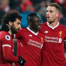 Liverpool's Sadio Mane celebrates with Mohamed Salah (L) and Jordan Henderson
