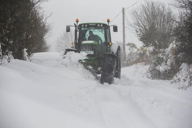 In Kilbraney, Co. Wexford yesterday even tractors found the going tough. Picture: Patrick Browne