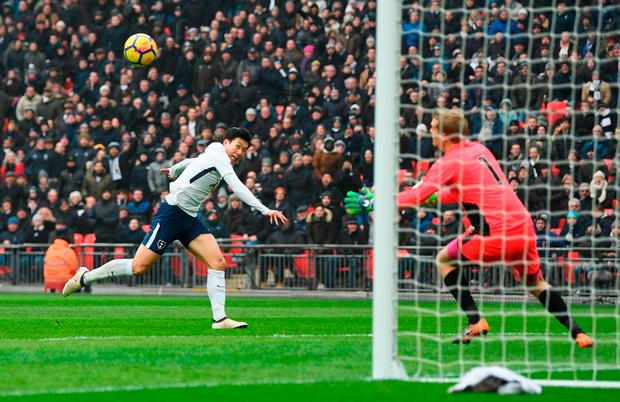 Heung-Min Son of Tottenham Hotspur scores their second goal past Jonas Loessl Photo: Getty