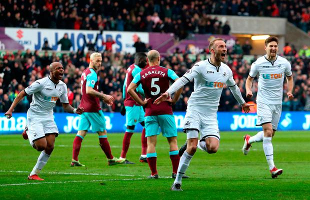Mike van der Hoorn of Swansea City scores his sides second goal Photo: Getty