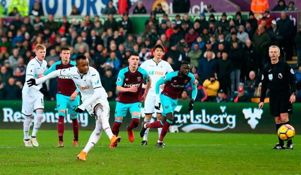 Jordan Ayew of Swansea City scores a penalty for his sides fourth goal Photo: Getty