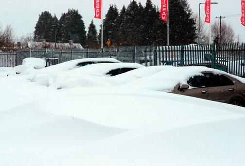 Cars buried in snow in Naas, Co Kildare as the severe weather conditions continued on Friday. Photo: Niall Carson/PA