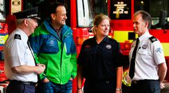 ENGINE ROOM: Taoiseach Leo Varadkar chats to Assistant Chief Fire Officer Dennis Kelly, Sub Officer Caroline Byrne and Paul LeStrange, Station Officer, at North Strand Fire Station, Dublin, during a visit yesterday. Photo: Steve Humphreys