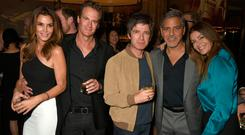 ROCK AND ROLL SPIRIT: Cindy Crawford, Rande Gerber, Noel Gallagher, George Clooney and Sara MacDonald at a celebrity event in London — the sort of do that drives Liam to tweet about his brother's