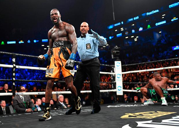 TOPSHOT - WBC heavyweight champion Deontay Wilder celebrates knocking down undefeated contender Luis King Kong Ortiz (R) during their 12-round WBC Heavyweight Championship fight at the Barclays Center in Brooklyn, New York March 3, 2018. / AFP PHOTO / TIMOTHY A. CLARYTIMOTHY A. CLARY/AFP/Getty Images
