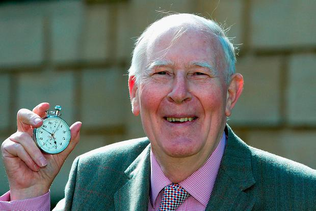FILE PHOTO OXFORD, ENGLAND - MAY 6: Sir Roger Bannister poses with the original stopwatchthat was used when recording the first sub 4 minute mile on May 6, 2004 at Pembroke College in Oxford, England. (Photo by Jamie McDonald/Getty Images)