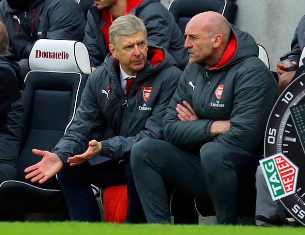 Arsenal manager Arsene Wenger (left) gestures on the bench during the Premier League match at the AMEX Stadium, Brighton. Gareth Fuller/PA Wire