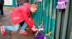 Supporters lay flowers and scarves to pay their homage to Davide Astori, outside the Artemio Franchi stadium, in Florence, Italy, Sunday, March 4, 2018. Maurizio Degl'Innocenti/ANSA via AP