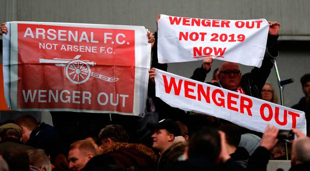 A section of fans protest against Arsenal manager Arsene Wenger following their defeat to Brighton at the Amex Stadium on Sunday. Photo: Catherine Ivill/Getty Images